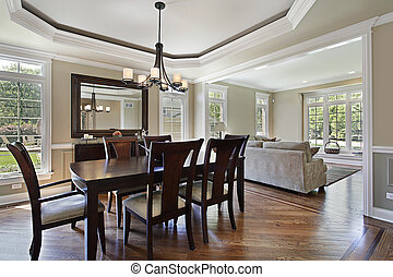 Dining room in luxury home with view into living area