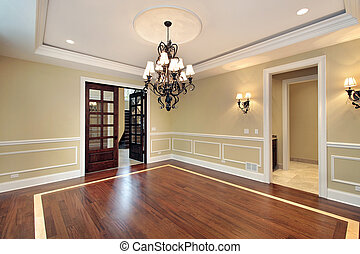 Dining room in new construction home with windowed doors