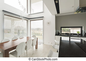 Dining room in residence - Modern dining room and kitchen in...