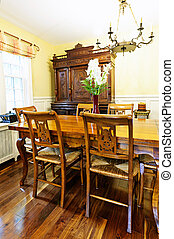 Dining room interior with antique wooden table and chairs in...