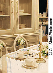 Dining room table with elegant setting - home interiors