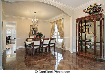 Dining room with arched entry