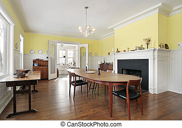 Dining room with black fireplace