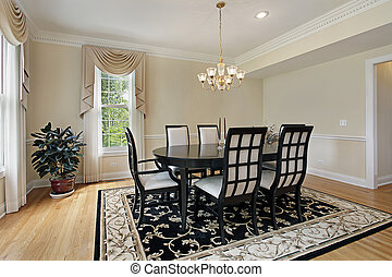 Dining room with black table - Dining room in suburban home ...