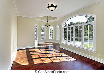 Dining room with cherry wood flooring - Dining room in new...