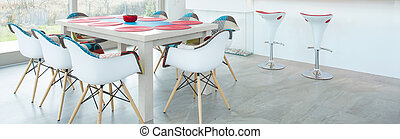Dining room with color elements - Modern dining table in...