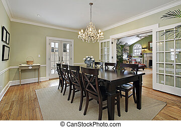 Dining room with door to patio - Dining room in luxury home...