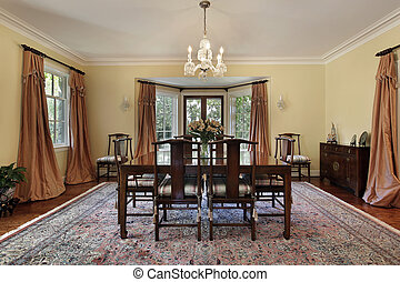 Dining room in suburban home with doors to patio