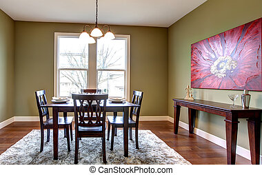 Dining room with green walls and red painting. - Beautiful...