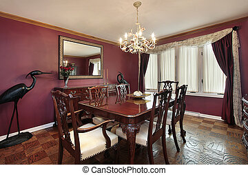 Dining room with maroon walls - Dining room in suburban home...