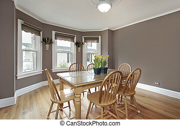 Dining room with mauve walls and wooden chairs