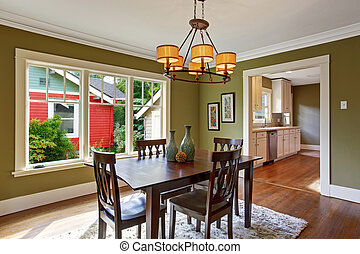 Dining room with olive tone walls