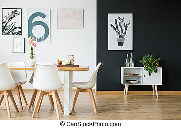 Dining room with plants - Black and white wall in dining...