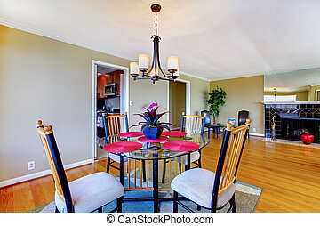 Dining room with round table and fireplace.