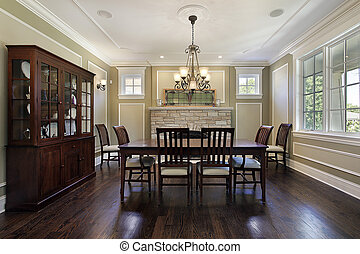 Dining room with stone fireplace