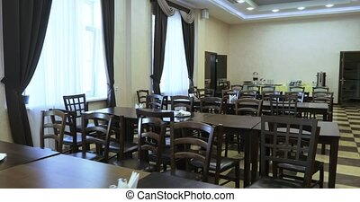 Dining room with tables and chairs - School canteen with the...