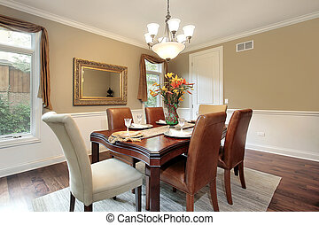 Dining room in luxury home with tan walls