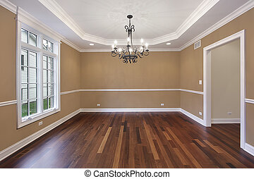Dining room in new construction home with tan walls