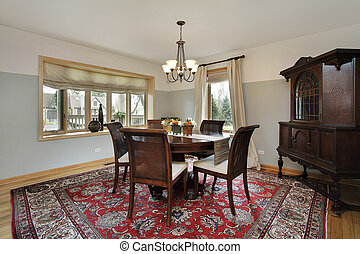 Dining room with wood trim windows