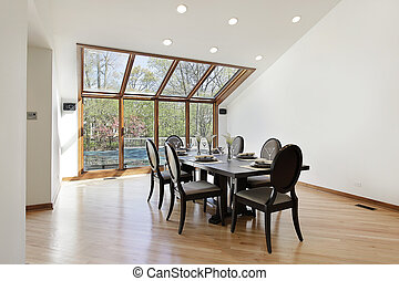 Dining room with wood trimed skylights
