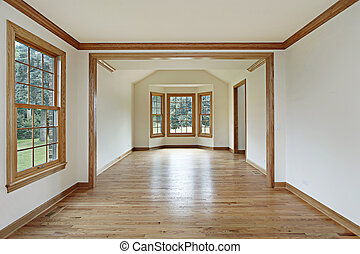 Dining room with wood walls