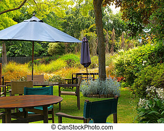 dining table in sunny garden patio with sunshade