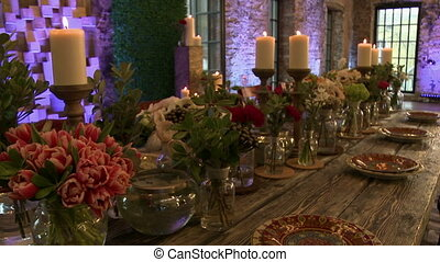 Dining table lavishly decorated with fresh flowers