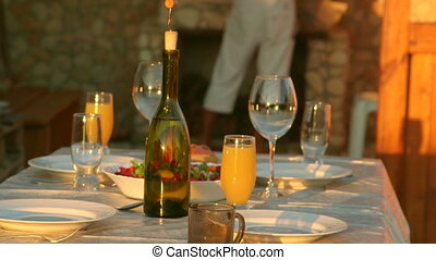 Dining table served simple food in backyard beside outdoor...