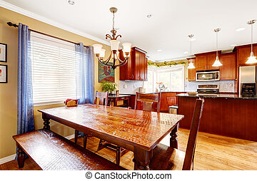 Dining table with bench and chairs in kitchen room