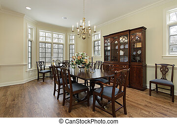 Diningroom with cream colored walls - Dining room in...