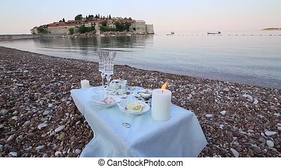 Dinner by the candlelight on the beach. A table for a romantic