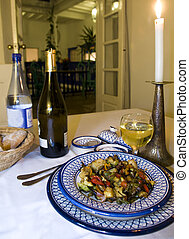 vegetable and chicken tagine dinner in riad hotel with classic moroccan architecture in essaouira morocco africa