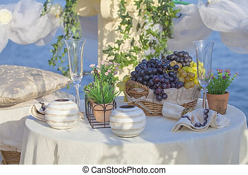 Dinner near the sea. - Decorated table for two near the sea.