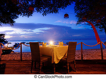 dinner on sunset at beach in Bali, Indonesia