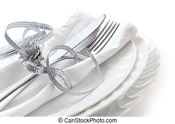 dinner party setting - close up od place setting on white...