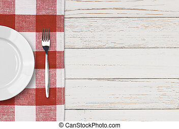 dinner plate, knife and fork setting on white table top view