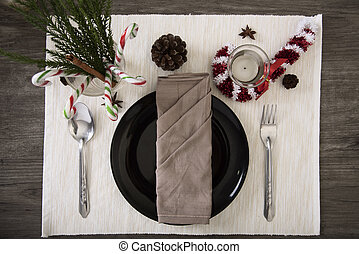 Dinner plate setting on wood table top view.