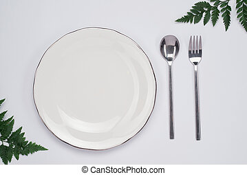 Dinner plate setting top view. Empty plate and silverware set on wooden table & Table setting empty plate and silverware on wooden table top view ...