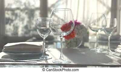 Dinner table close up. Empty wineglasses on tablecloth.
