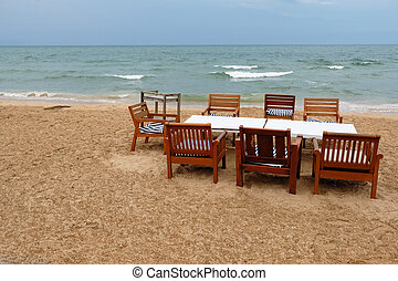 Dinner table set on the beach