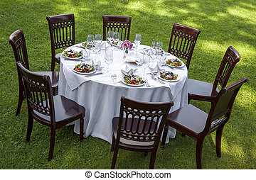 Dinner table - Table setting with chairs for garden banquet