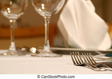 Dinner table - Plate, wine glass, napkin, fork and spoon...