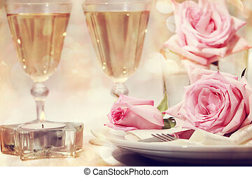 Dinner table with beautiful pink roses
