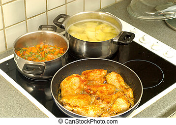 Dinner time, cooking potatoes, pees and carrots stewed with ...