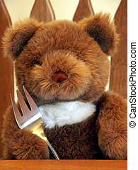 Dinner Time - Teddy bear with fork ready to eat dinner