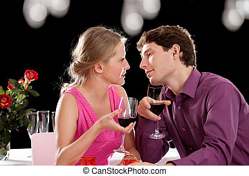 Dinner wine and love - An inlove woman and a man on a dinner...