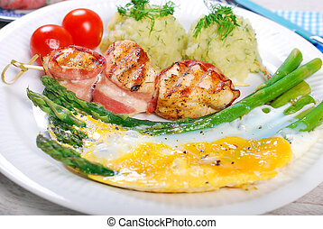 dinner with green asparagus baked on eggs