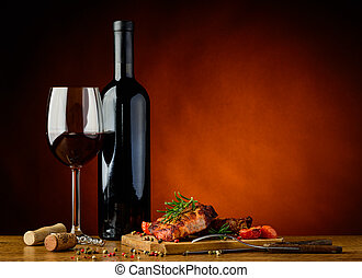Dinner with grilled steak and wine - still life with ...