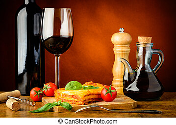 dinner with lasagne and red wine