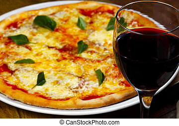 Dinner with wine and pizza